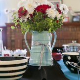 Red and white wedding flowers in turquoise farm vase