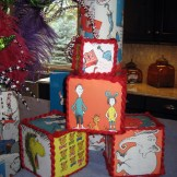 DIY Dr Seuss blocks made from styrofoam blocks and thrift store book pages.