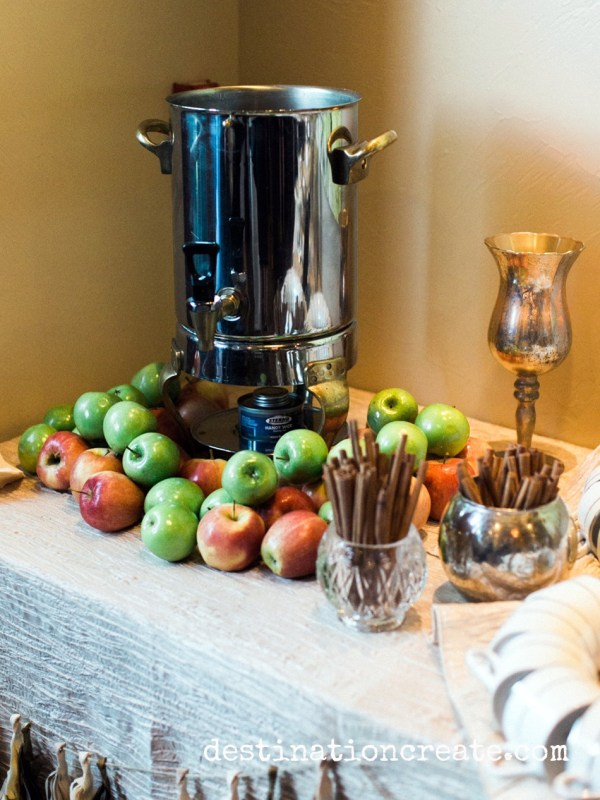 For the non-coffee drinkers on your guest list, hot apple cider is a delicious, warming alternative. Pile apples around the dispenser to entice guests