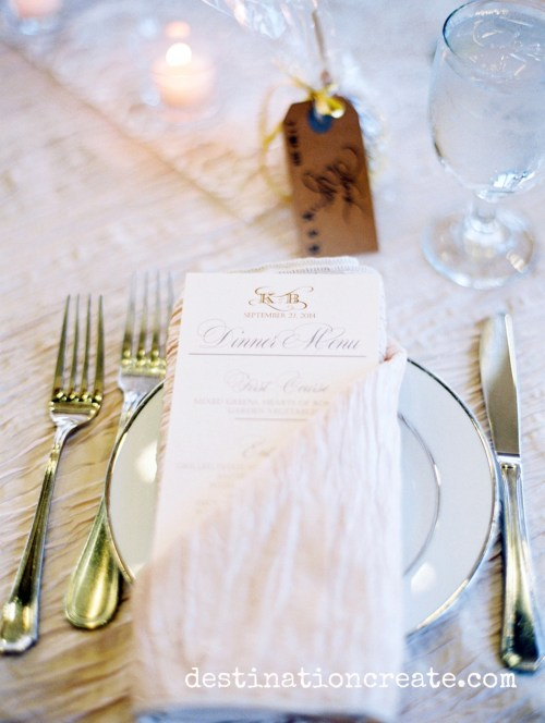 A menu at each place setting hints of delights to come at this blush & gold in Golden Colorado held at Rolling Hills Country Club