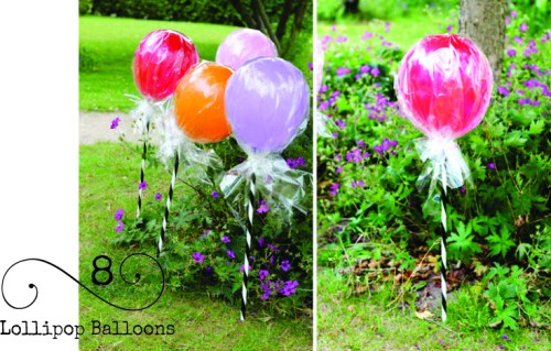 Oh my goodness...how cute is this? Cellophane wrapped balloons on a stick to create a lollipop garden!