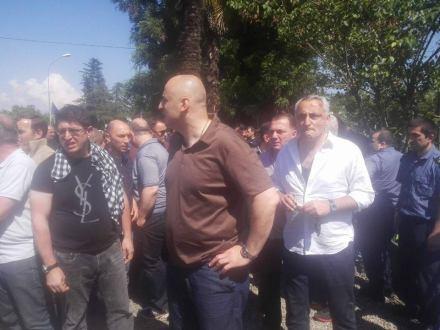 Nika Melia (center) and Tengiz Gunava, MP, in Kirtskheli after the incident. (20300