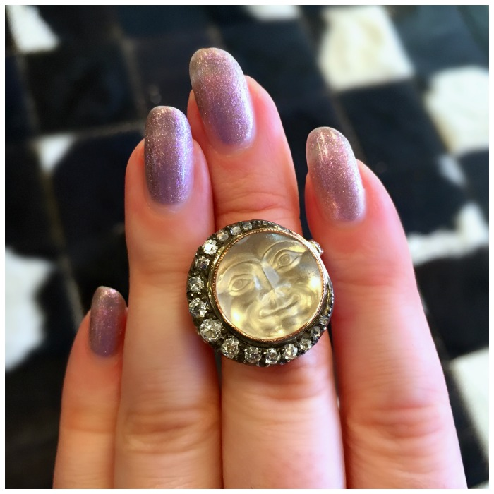 An incredible antique man in the moon ring from A Brandt and Son. Carved moonstone with diamonds.