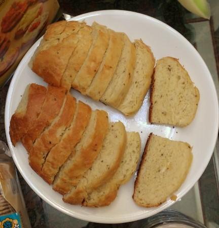 A sliced mollete loaf