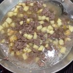 Cover beef and potatoes with water