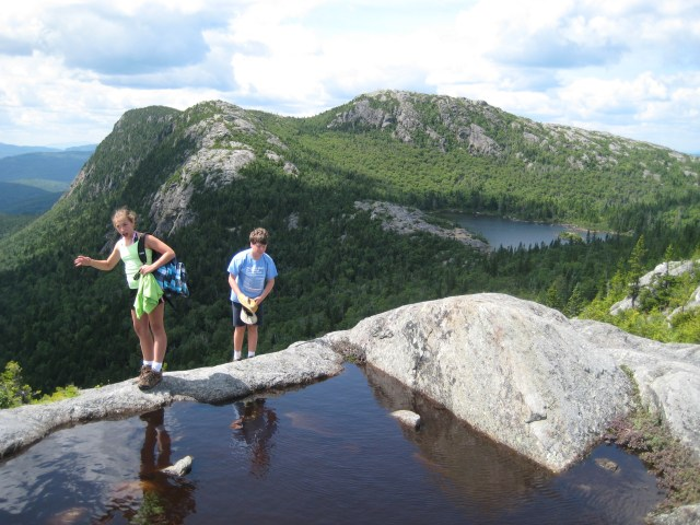 A view of Tumbledown Pond, and the mountain's summit, from the Parker Ridge Trail.