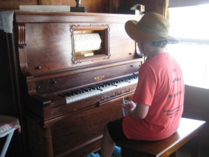 Visitors are encouraged to play Peary family's player piano, which is operated via a set of foot pedals.
