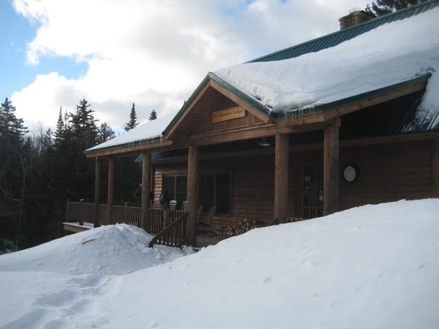 Little Lyford Lodge, where guests relax, and enjoy a full dinner and breakfast. The Lodge also provides a trail lunch to all guests. During our visit, temperatures were seasonable, but mild by mid-winter North Woods standards. Visitors wearing hats and mittens took full advantage of porch rocking chairs.