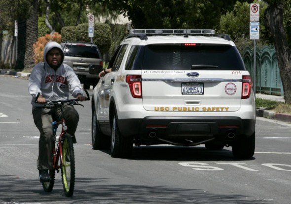 "A USC Public Safety vehicle drives on the street where two international students from China were shot dead on Wednesday in a ""gang-infested"" area near the University of Southern California, Los Angeles police in Los Angeles, California, April 11, 2012."