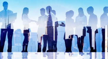 Silhouettes of Business People Communicating in a Cityscape