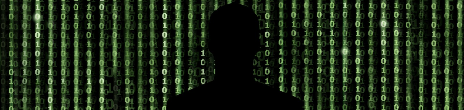 Silhouette of man looking through the digital matrix background
