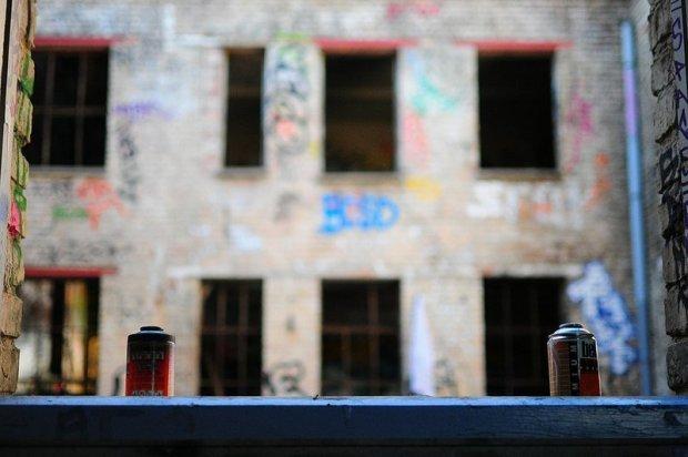spray cans on a windowsill