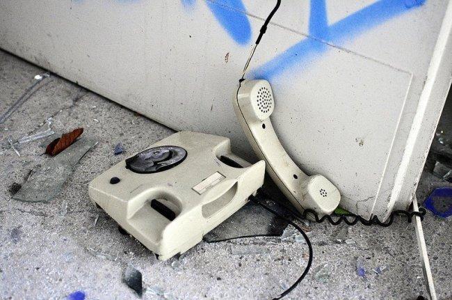 broken phone abandoned school