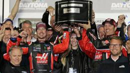 Kurt Busch (center left) and team members raise the trophy in Victory Lane after winning the NASCAR Daytona 500 auto race at Daytona International Speedway in Daytona Beach, Fla., Sunday, Feb. 26, 2017. (AP)