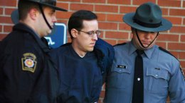 In this Jan. 5, 2015, file photo, Eric Frein is led away by Pennsylvania State Police Troopers at the Pike County Courthouse after his preliminary hearing in Milford, Pa. (AP)