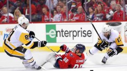 Washington Capitals defenseman Nate Schmidt (88) falls on the ice between Pittsburgh Penguins right wing Phil Kessel (81) and right wing Bryan Rust (17) during the second period of Game 1 in an NHL hockey Stanley Cup second-round playoff series, Thursday, April 27, 2017, in Washington. (AP)