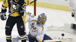 AP Pittsburgh's Jake Guentzel and Nashville's Pekka Rinne watch Evgeni Malkin's shot go into the net.