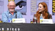 """Liam Cunningham, left, and Sophie Turner attend the """"Game of Thrones"""" panel on day two of Comic-Con International on Friday, July 21, 2017, in San Diego. (AP)"""