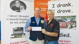 Ben Pfeufer (left), manager of WalMart in Clarion presents a check for $850 to Vernon Hilyer, executive director of the Brandon's Dad organization. The donation was made possible through the WalMart Community Grant program. (Submitted photo)
