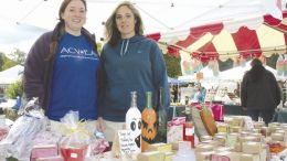 Kristen Hurrelbrink of Sugar Valley near Lamartine and Amy McCoy of Kennerdell were on hand at the 2016 Foxburg Fall Festival selling their locally made wares soaps made by Hurrelbrink and art made by McCoy. The Foxburg festival drew a large number of people this year. (Submitted photo)