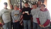 Pictured are members Dave Cherry (from left) and Desiree Rhodes, Treasurer Mick Ace, President of the Neil Sneeringer and Fallen Friends' Memorial Doug Carter, President of the United Military Support Group Ron Miller, Secretary Linda Walker, and Vice President Shirley Miller. (Submitted photo)
