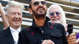 In this Friday, July 7, 2017 file photo, Ringo Starr, center, is joined by guests including filmmaker David Lynch, left, and musician Edgar Winter, second from right, during a 77th birthday celebration for Starr outside Capitol Records, in Los Angeles. (AP)