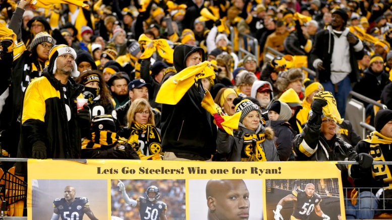 Pittsburgh Steelers' fans cheer behind a sign showing support for injured inside linebacker Ryan Shazier (50) during an NFL football game against the Baltimore Ravens, Sunday, Dec. 10, 2017, in Pittsburgh. (AP)