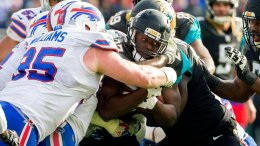 In this Jan. 7, 2018, file photo, Jacksonville Jaguars running back Leonard Fournette (27) is stopped by the Buffalo Bills defense during the second half of an NFL wild-card playoff football game in Jacksonville, Fla. (AP)