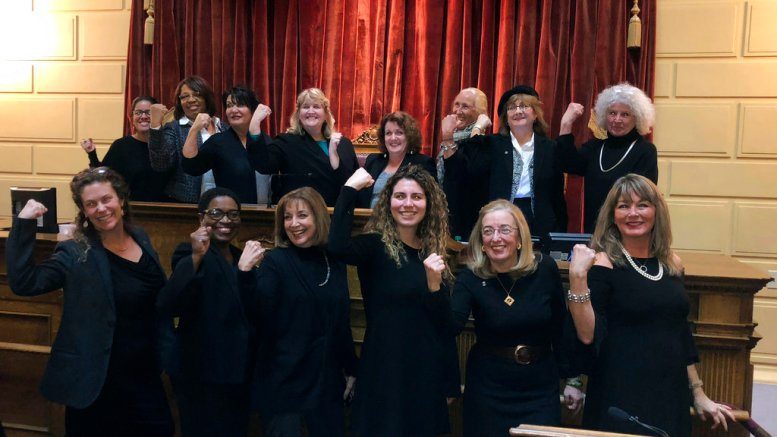Rhode Island lawmakers wearing black to in solidarity with the Time's Up movement and as a statement against sexual misconduct stand at the House speaker's rostrum at the Statehouse in Providence, R.I., on Tuesday, Jan. 9., 2018. (AP)