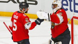 Florida Panthers goaltender Roberto Luongo (1) celebrates a victory over the Pittsburgh Penguins with defenseman Aaron Ekblad (5) after the third period of an NHL hockey game, Saturday, Feb. 24, 2018, in Sunrise, Fla. (AP)