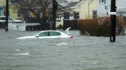 A car along Sea St.,  is under several feet of water during the storm, Friday, March 2, 2018 in Quincy, Mass. (AP)