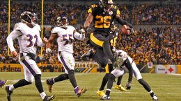 In this Dec. 25, 2016, file photo, Pittsburgh Steelers running back Le'Veon Bell (26) leaps into the end zone ahead of Baltimore Ravens strong safety Eric Weddle (32) for a touchdown during the second half of an NFL football game in Pittsburgh. (AP)