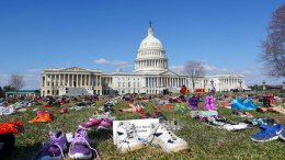 7000 pairs of shoes, one for every child killed by gun violence since the Sandy Hook school shooting, were placed on the Capitol lawn by Avaaz, a U.S.-based civic organization, on Capitol Hill in Washington, Tuesday, March 13, 2018. (AP)