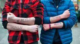 Pittsburgh Creative and Performing Arts School students Ian Aiken (left), 14, of West End, and Aiden Magley, 15, of Point Breeze, stand for a photo with #NeverAgain written in marker on their arms at Market Square, Wednesday, March 14, 2018, in Pittsburgh. (AP)