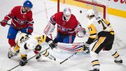 Pittsburgh Penguins right wing Patric Hornqvist (72) scores against Montreal Canadiens goaltender Antti Niemi (37) as Penguins center Evgeni Malkin (71) and Canadiens defenseman Noah Juulsen (58) look for the rebound during the third period of an NHL hockey game Thursday, March 15, 2018, in Montreal. (AP)