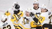 Pittsburgh Penguins right wing Patric Hornqvist (72) celebrates with left wing Carl Hagelin (62), defenseman Kris Letang (58) and center Evgeni Malkin (71) after scoring against the Montreal Canadiens during the third period of an NHL hockey game Thursday, March 15, 2018, in Montreal. (AP)