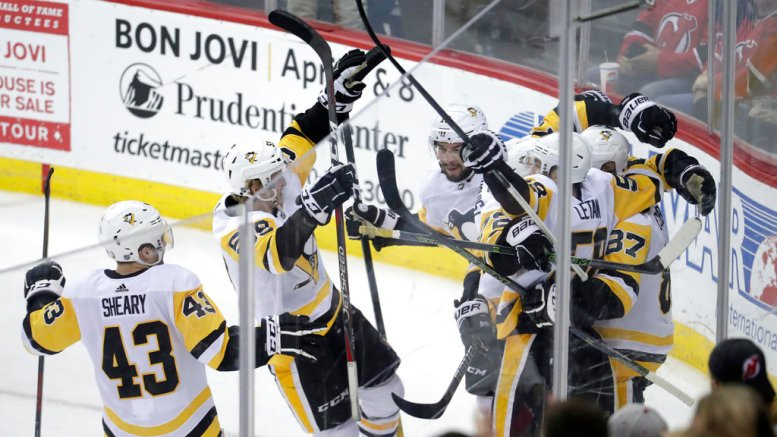Pittsburgh Penguins players celebrate an overtime goal by Sidney Crosby (right) during an NHL hockey game against the New Jersey Devils on Thursday, March 29, 2018, in Newark, N.J. The Penguins won 4-3. (AP)