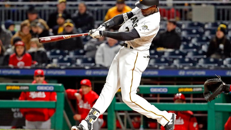 Pittsburgh Pirates' Gregory Polanco hits a two-run home run off Cincinnati Reds starting pitcher Homer Bailey during the fifth inning of a baseball game in Pittsburgh, Thursday, April 5, 2018. (AP)