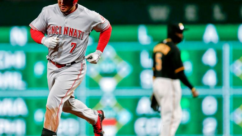 Cincinnati Reds' Eugenio Suarez rounds second behind Pittsburgh Pirates second baseman Josh Harrison after hitting a three-run-home run in the eighth inning of a baseball game, Saturday, April 7, 2018, in Pittsburgh. (AP)
