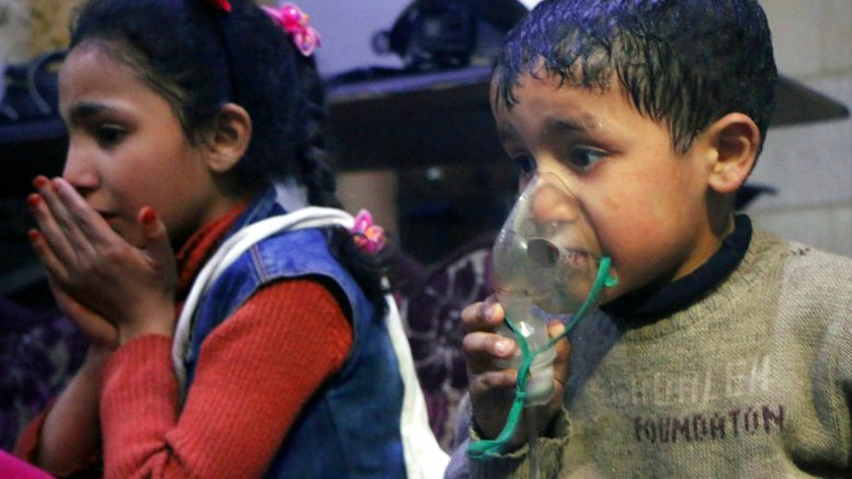 This image released early Sunday, April 8, 2018, by the Syrian Civil Defense White Helmets, shows a child receiving oxygen through respirators following an alleged poison gas attack in the rebel-held town of Douma, near Damascus, Syria. (AP)