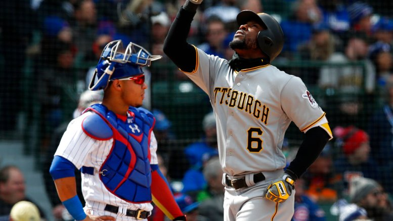 Pittsburgh Pirates' Starling Marte celebrates his home run as he crosses home plate in front of Chicago Cubs catcher Willson Contreras during the fourth inning of a baseball game, Tuesday, April 10, 2018, in Chicago. (AP)