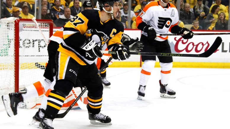 Pittsburgh Penguins' Sidney Crosby (87) redirects a shot past Philadelphia Flyers goaltender Brian Elliott for a goal during the second period in Game 1 of an NHL first-round hockey playoff series in Pittsburgh, Wednesday, April 11, 2018. (AP)