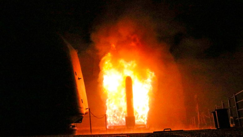 In this image provided by the U.S. Navy, the guided-missile cruiser USS Monterey (CG 61) fires a Tomahawk land attack missile early Saturday, April 14, 2018, as part of the military response to Syria's use of chemical weapons on April 7. (AP)