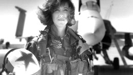 In this image provided by the U.S. Navy, Lt. Tammie Jo Shults, one of the first women to fly Navy tactical aircraft, poses in front of an F/A-18A with Tactical Electronics Warfare Squadron (VAQ) 34 in 1992. After leaving active duty in early 1993, Shults served in the Navy Reserve until 2001. Shults was the pilot of the Southwest plane that made an emergency landing on April 17, 2018, after an engine explosion. (U.S. Navy via AP)