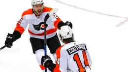 Philadelphia Flyers' Sean Couturier (14) celebrates his goal with teammate Scott Laughton (21) during the third period in Game 5 of an NHL first-round hockey playoff series against the Pittsburgh Penguins in Pittsburgh, Friday, April 20, 2018. (AP)