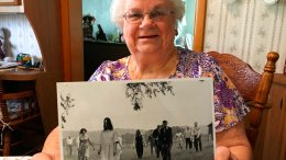 "In this April 21, 2018 photo, Ella Mae Smith, 86, of Evans City, P.a, poses with a publicity photo from the horror movie ""Night of the Living Dead.""  (Jason Nark/The Philadelphia Inquirer via AP)"