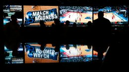 In this March 15, 2018, photo, people watch coverage of the first round of the NCAA college basketball tournament at the Westgate Superbook sports book in Las Vegas. (AP)