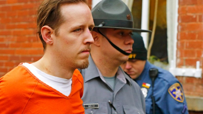 In this Oct. 31, 2014, file photo, Eric Frein is escorted out by police after his arraignment at the Pike County Courthouse in Milford, Pa. (AP)