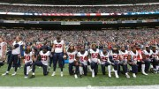 In this Oct. 29, 2017, file photo, Houston Texans players kneel and stand during the singing of the national anthem before an NFL football game against the Seattle Seahawks, in Seattle. (AP)