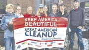 "A partial group of volunteers gather after the clean-up holding a banner that says ""Keep America Beautiful"" which is the motto of The Great American Cleanup of Pennsylvania. (Submitted photo)"